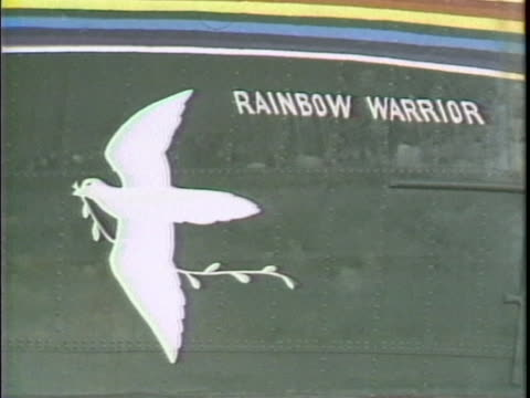 wide shot of rainbow warrior in the water rainbow warrior dove, rainbow and name painted on side - (war or terrorism or election or government or illness or news event or speech or politics or politician or conflict or military or extreme weather or business or economy) and not usa stock videos & royalty-free footage