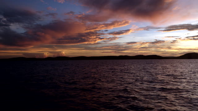 wide shot of raine island from boat at dusk - dramatic sky stock videos & royalty-free footage
