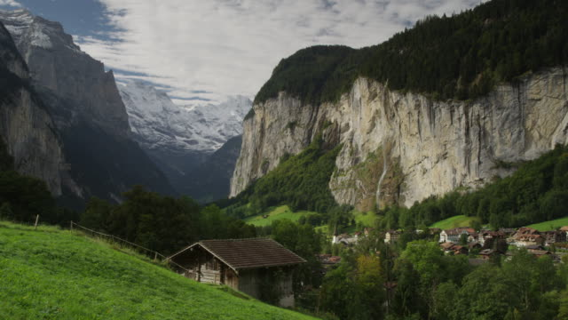 Wide shot of remote village in mountain valley / Lauterbrunnan, Switzerland