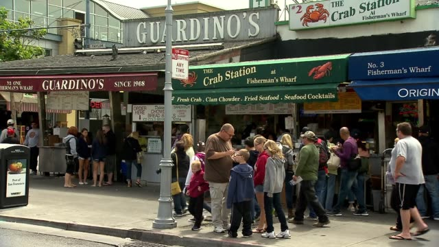 A wide shot of restaurants at Fisherman's Wharf in San Francisco on July 17 A tight shot of restaurants at Fisherman's Wharf in San Francisco with...