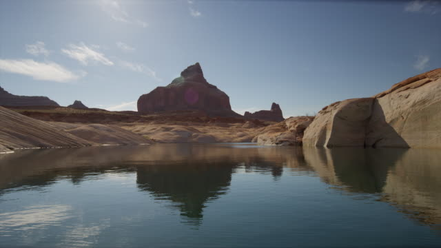 wide shot of rock formation and lake / lake powell, utah, united states - lake powell stock videos & royalty-free footage