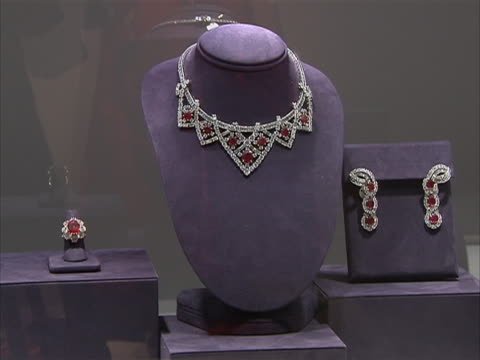 wide shot of ruby and diamond jewelry owned by actor and philanthropist elizabeth taylor. these jewels were part of a four-day charity auction of... - auction stock videos & royalty-free footage