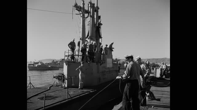 wide shot of sailors docking us navy submarine at harbor - looking away stock videos & royalty-free footage