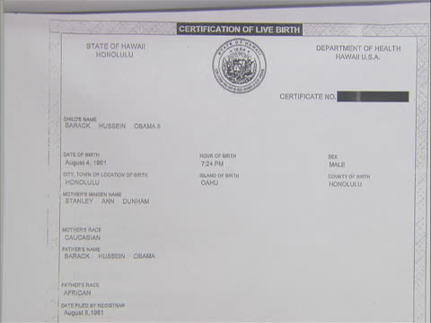 wide shot of second page of president barack obama's birth certificate. the president released his original birth certificate to quiet those who had... - nuova vita video stock e b–roll