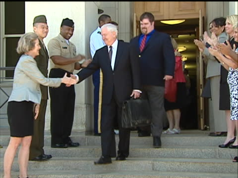 wide shot of secretary of defense robert gates exiting the pentagon and shaking hands with staffers on his final day of work on june 30th 2011 gates... - department of defense stock videos & royalty-free footage