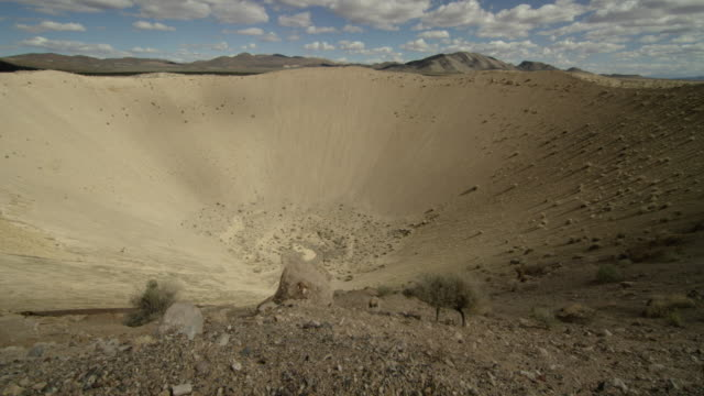 wide shot of sedan crater explosion crater at nevada test site - sedan stock videos & royalty-free footage