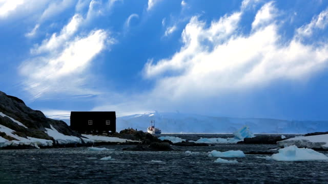 wide shot of ship at polar base on wiencke island in antarctica - glacier stock videos & royalty-free footage