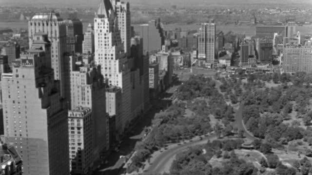 wide shot of skyscrapers on 59th street by central park in manhattan, new york city, new york state, usa - 1937 stock videos & royalty-free footage