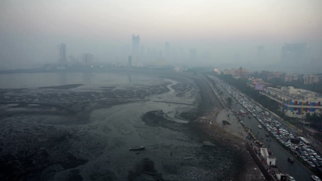 wide shot of smoggy mumbai skyline - smog video stock e b–roll