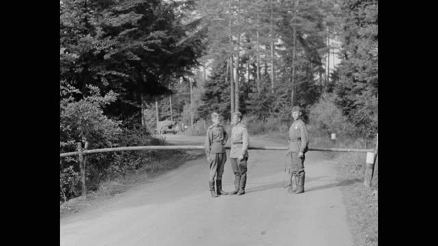 wide shot of soviet soldiers standing in front of road block check point, post wwii germany - postwar stock videos & royalty-free footage