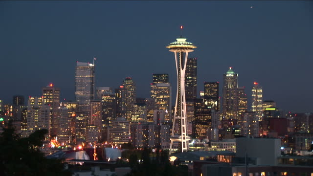 wide shot of space needle tower at night in seattle united states - washington mutual tower stock videos & royalty-free footage