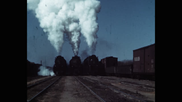 wide shot of steam trains moving on railroad tracks - locomotive stock videos & royalty-free footage