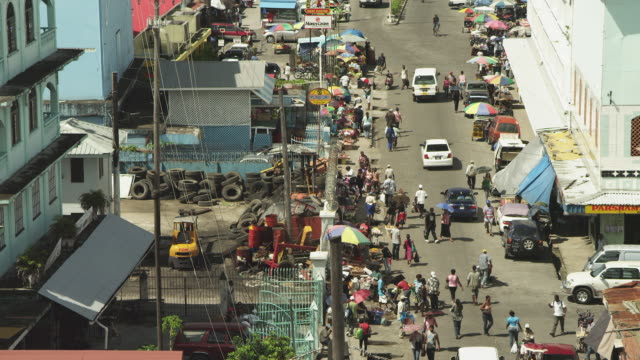 wide shot of street market, crowds and cars - guyana stock videos & royalty-free footage