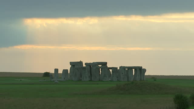 wide shot of sunbeams shining through the clouds at stonehenge on august 28, 2018 in wiltshire, england. - wide angle stock videos & royalty-free footage