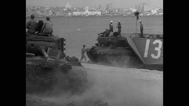 wide shot of tanks loading on ship at harbor at camp pendleton, california - medium group of people stock videos & royalty-free footage