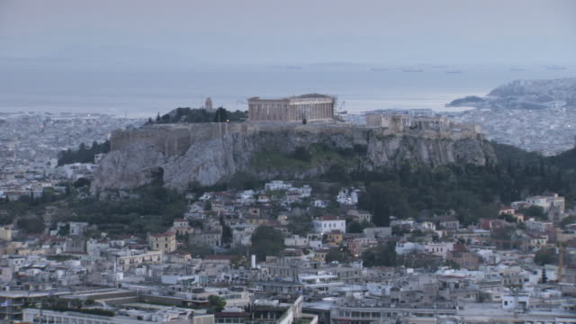 Wide shot of the Acropolis of Athens as dusk settles, Greece.
