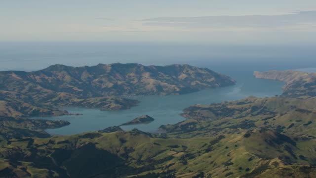 wide shot of the akaroa harbor in banks peninsula - akaroa stock videos & royalty-free footage