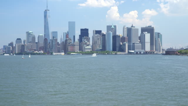 Wide shot of the approach to Manhattan via the Hudson River.