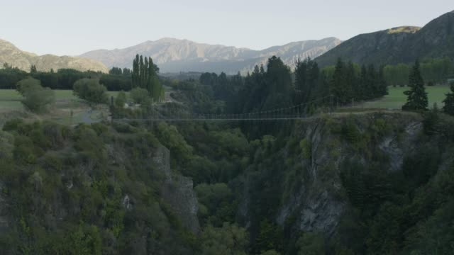 wide shot of the arrow river bridge above the kawarau river - suspension bridge stock videos & royalty-free footage