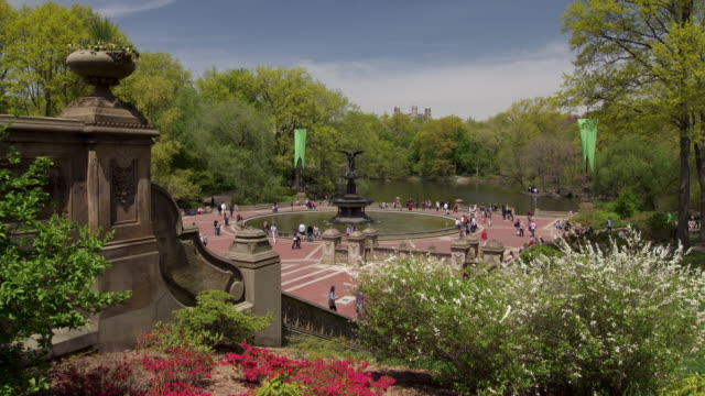 Wide shot of the Bethesda Fountain in Central Park, NYC. A portion of the Lake can be seen in the background.