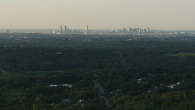 wide shot of the boston skyline seen from above the blue hills reservation - back bay stock-videos und b-roll-filmmaterial