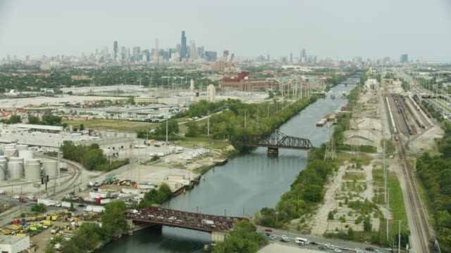 wide shot of the chicago sanitary and ship canal with downtown chicago in the background - industrial district stock videos & royalty-free footage