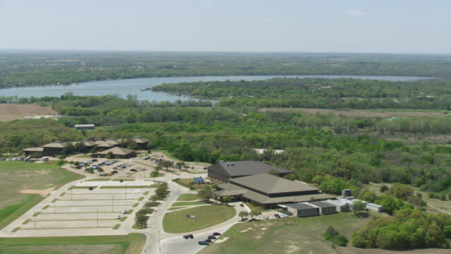 wide shot of the eagle mountain international church with the eagle mountain lake in the background - pastor stock videos & royalty-free footage