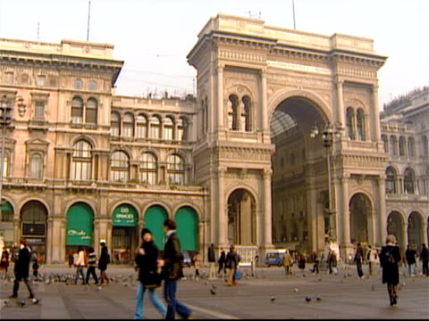 wide shot of the entrance to the galleria vittorio emanuele ii off the piazza del duomo / milan, italy - piazza del duomo milan stock videos and b-roll footage