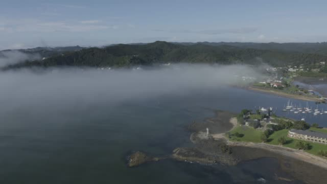wide shot of the foggy teti bay - bay of islands new zealand stock videos & royalty-free footage