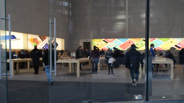 A wide shot of the glass façade of an Apple Store in New York City on January 23 A tilt down of the glass façade A tight shot of the Apple logo...