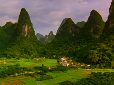 wide shot of the guilin mountains in china. guilin is a prefecture-level city in the northeast of the guangxi zhuang autonomous region of far... - guangxi zhuang autonomous region china stock videos & royalty-free footage