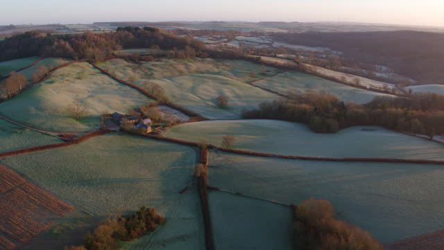 wide shot of the hilly fields in south west england at dawn - pasture stock videos & royalty-free footage
