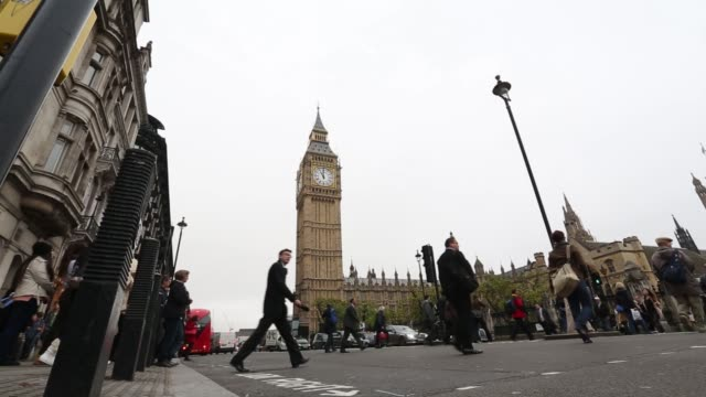 Wide shot of the Houses of Parliament on a gloomy day in Westminster London on Tuesday October 14 pedestrians crossing the street backdropped by...