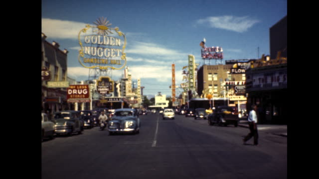 """wide shot of the las vegas strip in the 40's. classic cars drive by as we see a huge sign for the """"golden nugget."""" - las vegas stock videos & royalty-free footage"""