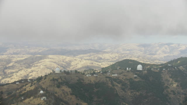 wide shot of the lick observatory appearing from behind the clouds - san jose california stock videos & royalty-free footage