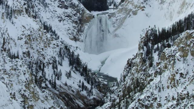 wide shot of the lower yellowstone falls at winter - river yellowstone stock videos & royalty-free footage