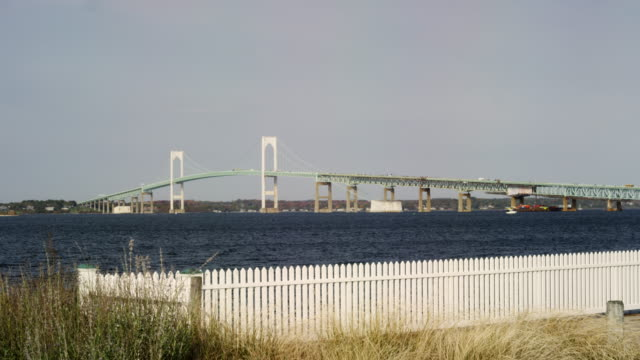 wide shot of the newport bridge with picket fence in the foreground - picket fence stock videos & royalty-free footage