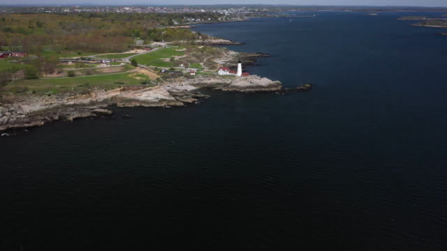 wide shot of the portland head light and the fort williams park - north atlantic ocean stock videos & royalty-free footage