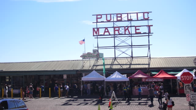 wide shot of the 'public market' sign at the iconic pike place market in downtown seattle washington no - pike place market stock videos and b-roll footage