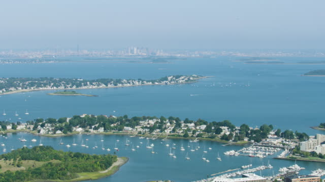 wide shot of the quincy bay with houghs neck in the foreground - massachusetts stock videos & royalty-free footage
