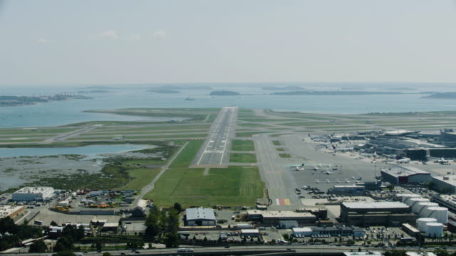 wide shot of the runway of the logan international airport - taxiway stock-videos und b-roll-filmmaterial