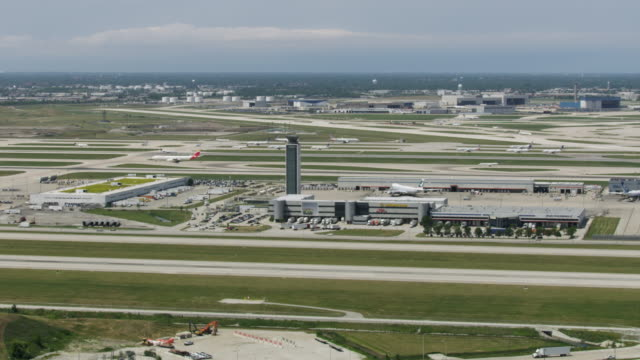 wide shot of the south air traffic control tower of the o'hare international airport - taxiway stock videos & royalty-free footage