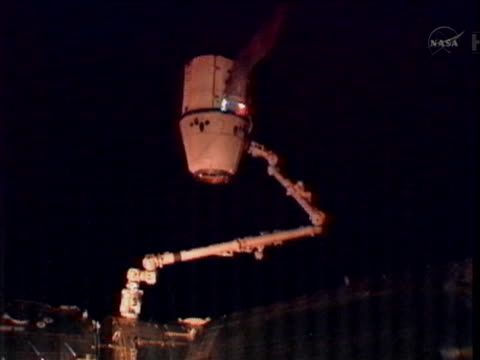 wide shot of the spacex dragon capsule preparing to undock from the international space station and head back to earth - head back stock videos & royalty-free footage