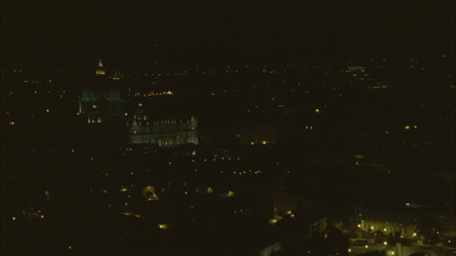 Wide shot of the St Peters Basilica at night.