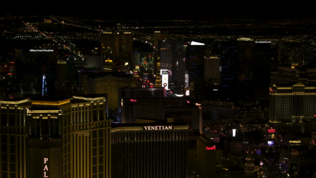 wide shot of the strip in las vegas at night - the palazzo las vegas stock videos & royalty-free footage