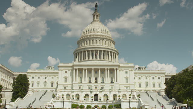 wide shot of the west front of the united states capitol building on a sunny day, washington, d.c., usa. - capitol building washington dc stock videos and b-roll footage