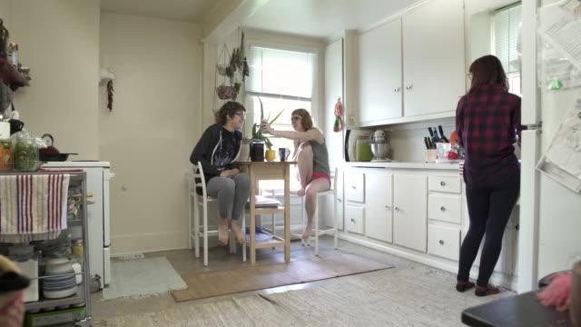 Wide shot of three women in a kitchen