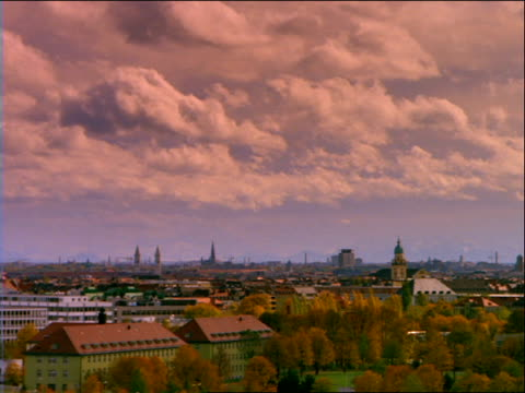wide shot of time lapse clouds over skyline in autumn / munich - 1992 stock videos & royalty-free footage
