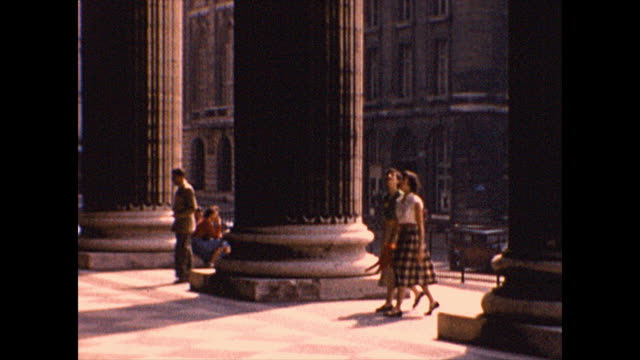 wide shot of tourists entering the pantheon, view of the eiffel tower through columns. from the collection of world-famous still photographer,... - pantheon paris stock videos & royalty-free footage