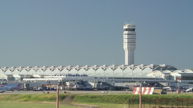Wide shot of traffic control tower at airport / Washington D.C., District of Columbia, United States